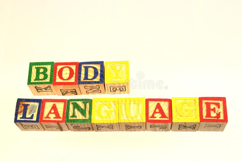 The term body language. Displayed visually using colorful wooden toy blocks royalty free stock image