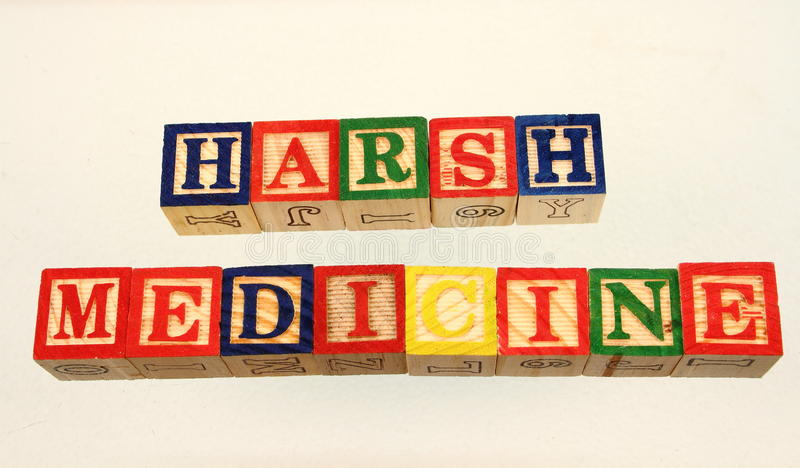 The term harsh medicine. Displayed visually on a white background using colorful wooden toy blocks royalty free stock photos