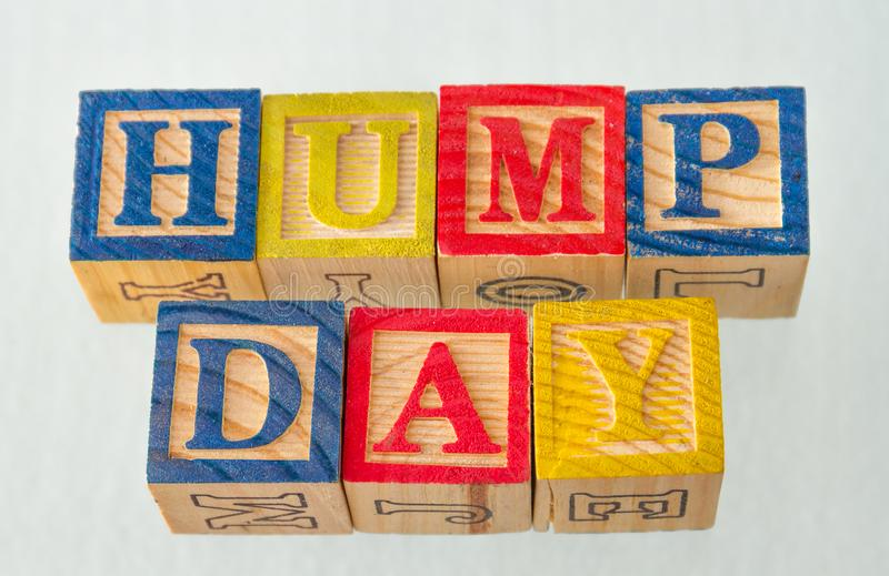The term hump day visually displayed. On a white background using colorful wooden blocks image in landscape format stock image