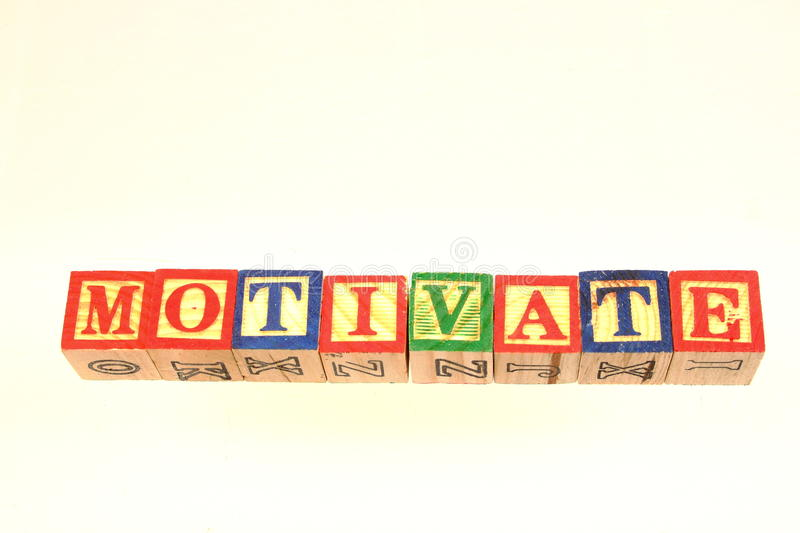 The term motivate. Displayed visually using colorful wooden toy blocks royalty free stock photography