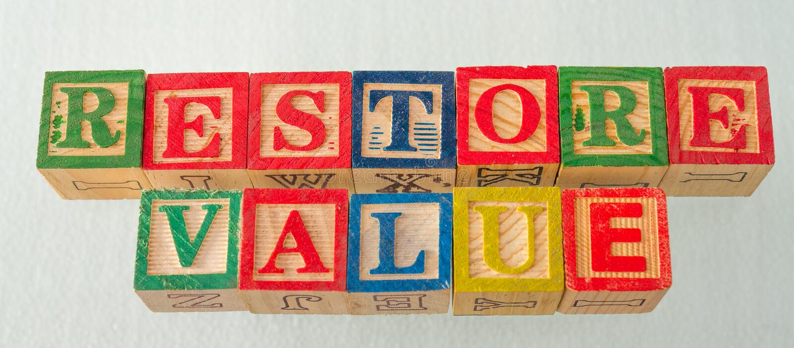 The term restore value visually displayed. On a white background using colorful wooden blocks image in landscape format stock photography