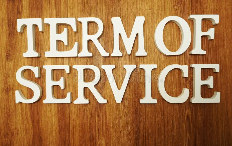 Term Of Service word alphabet letters on wooden background stock images