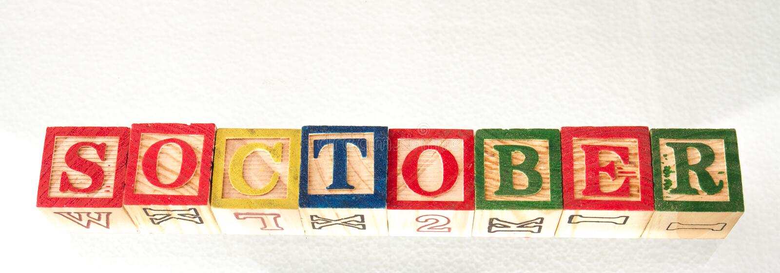 The term soctober visually displayed. The term soctober displayed visually on a white background using colorful wooden toy blocks image with copy space in stock images