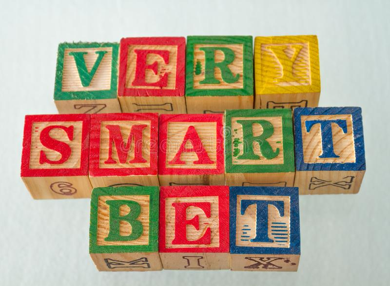 The term very smart bet visually displayed. On a white background using colorful wooden blocks image in landscape format royalty free stock image