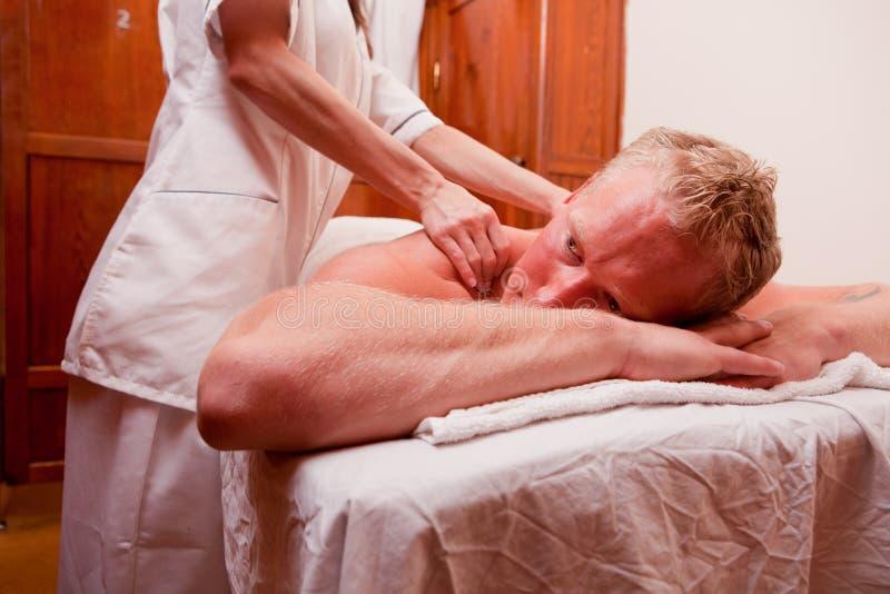 Termas da massagem do homem fotografia de stock
