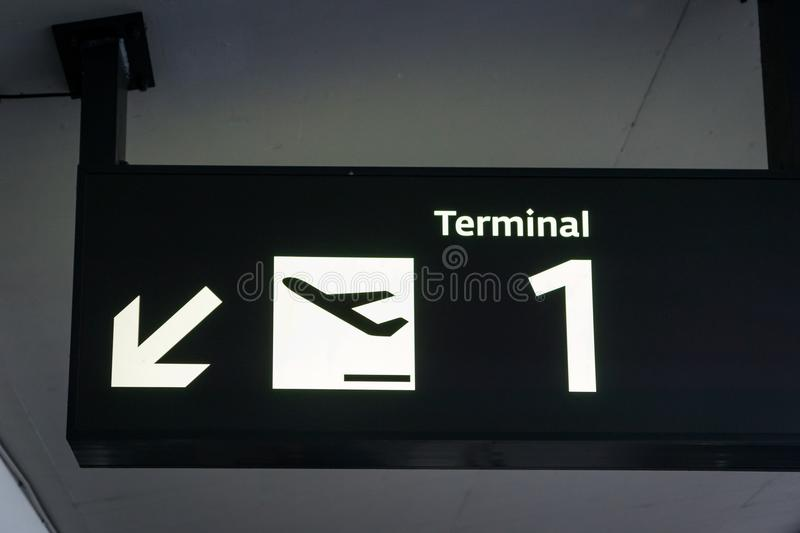 Terminal signboard icon in an international airport. A terminal signboard icon in an international airport stock photo