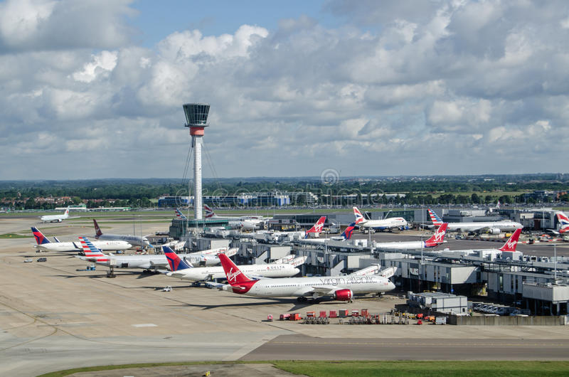 Terminal Three, Heathrow Airport. LONDON, UK - JUNE 3, 2017: View from the air of planes parked at Terminal 3 of London`s Heathrow Airport on a sunny summer stock image