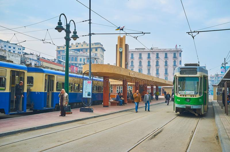On terminal tram station of Alexandria, Egypt. ALEXANDRIA, EGYPT - DECEMBER 18, 2017: The crowded tram terminal station with vintage trams, located in Mahta al royalty free stock photos