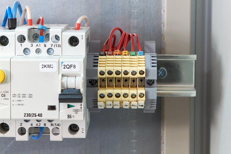 Through terminals, circuit breaker, modular contactor and RCD in electrical Cabinet. Automation and distribution of electricity. Modern production technology royalty free stock photo