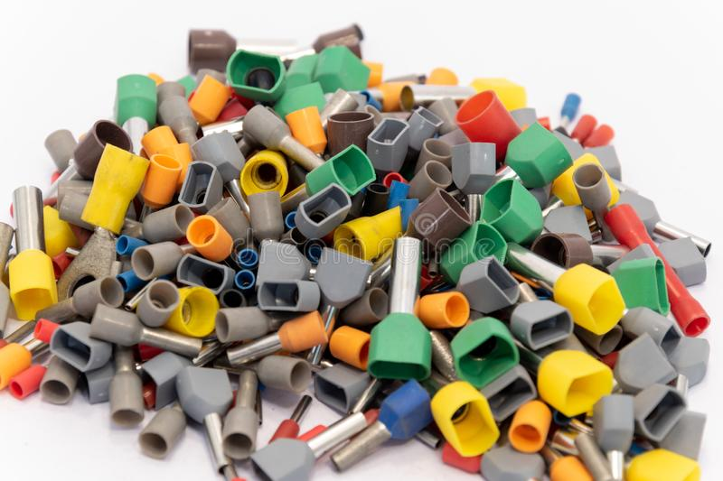 Terminals for electric conductors in d ifferent sizes. So-called hollow-tip terminals for electric conductors in different color codes and sizes royalty free stock photo