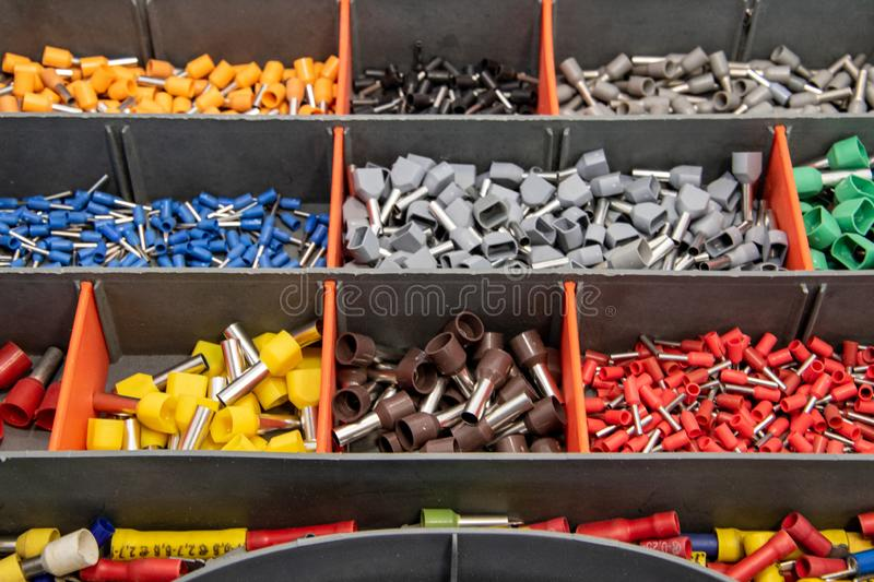 Terminals for electric conductors in d ifferent sizes. So-called hollow-tip terminals for electric conductors in different color codes and sizes royalty free stock photography