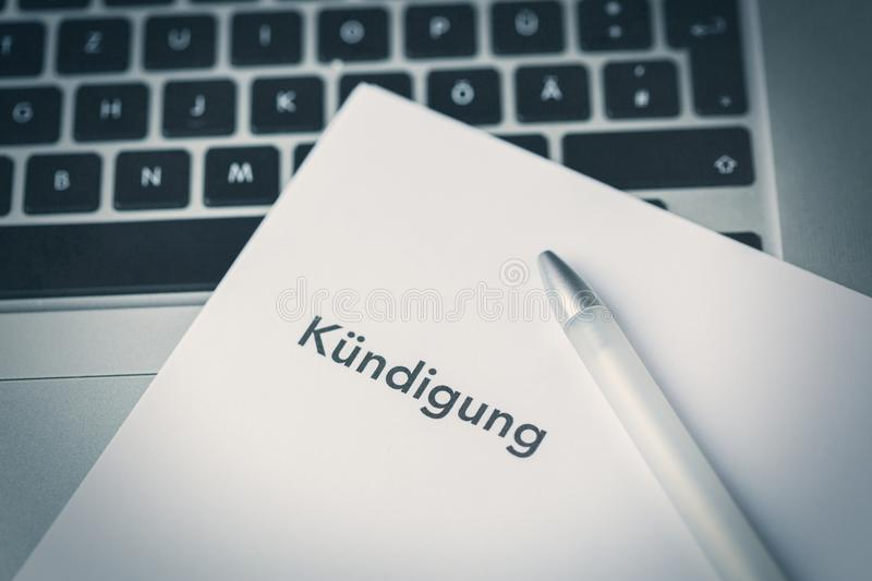 Termination letter - Kundigung - and pen stock photo