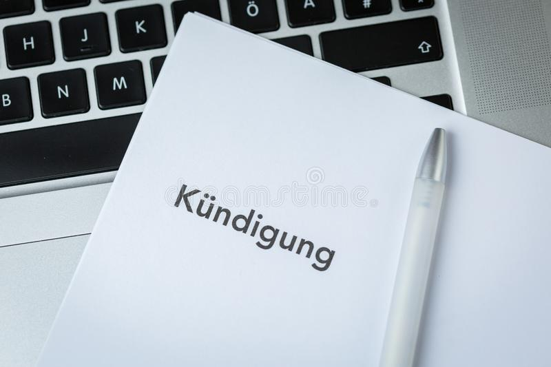 Termination letter - Kundigung - and pen royalty free stock photos