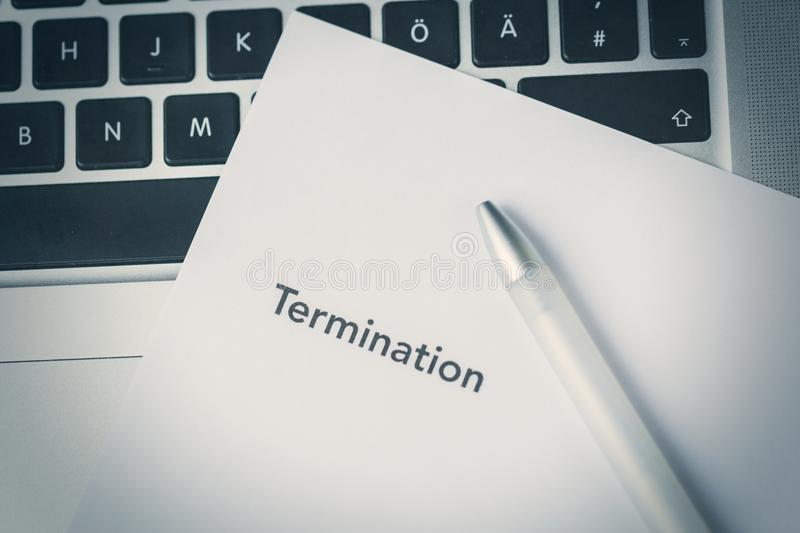 Termination letter lying on a laptop computer royalty free stock photo