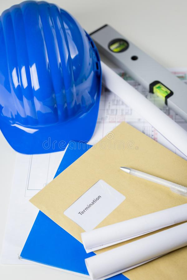Termination notice lying on an architects desk royalty free stock image