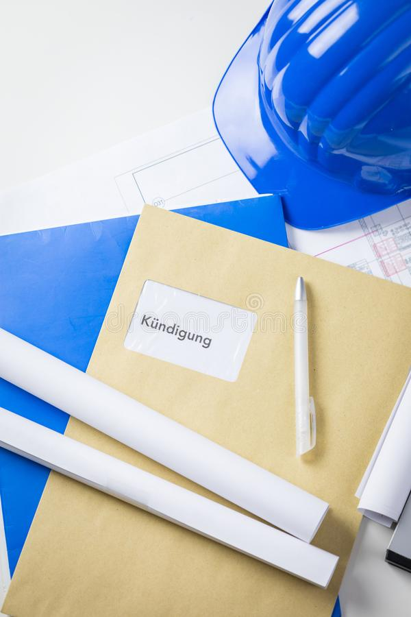 Termination notice in german lying on an architects desk royalty free stock image