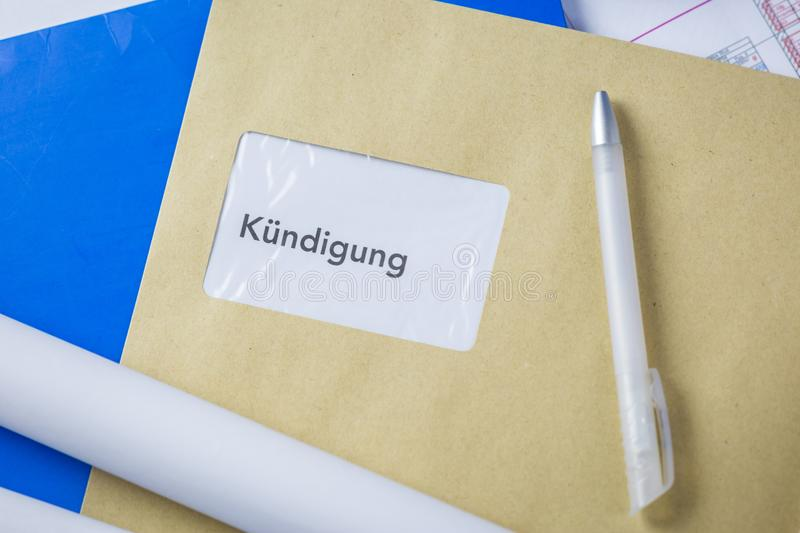 Termination notice in german lying on an architects desk royalty free stock images
