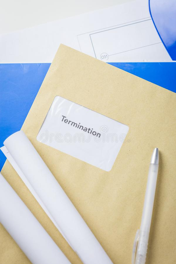Termination notice lying on an architects desk stock photo