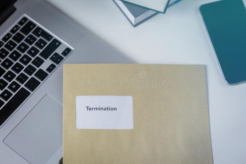 Termination or severance letter lying on a desk royalty free stock image
