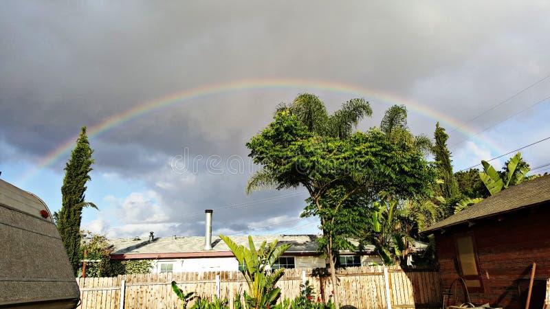 Termine o arco-íris foto de stock