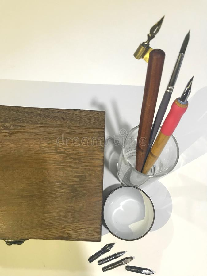 Termine o conjunto de ferramentas tradicional da caligrafia imagens de stock royalty free