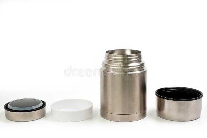 Termo ligero, metálico para comer con una placa plástica en un fondo blanco fotos de archivo