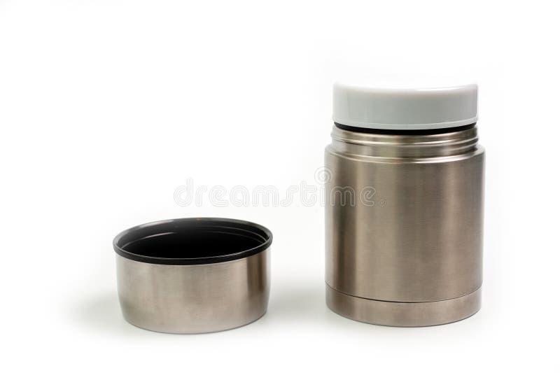 Termo ligero, metálico para comer con una placa plástica en un fondo blanco fotografía de archivo libre de regalías