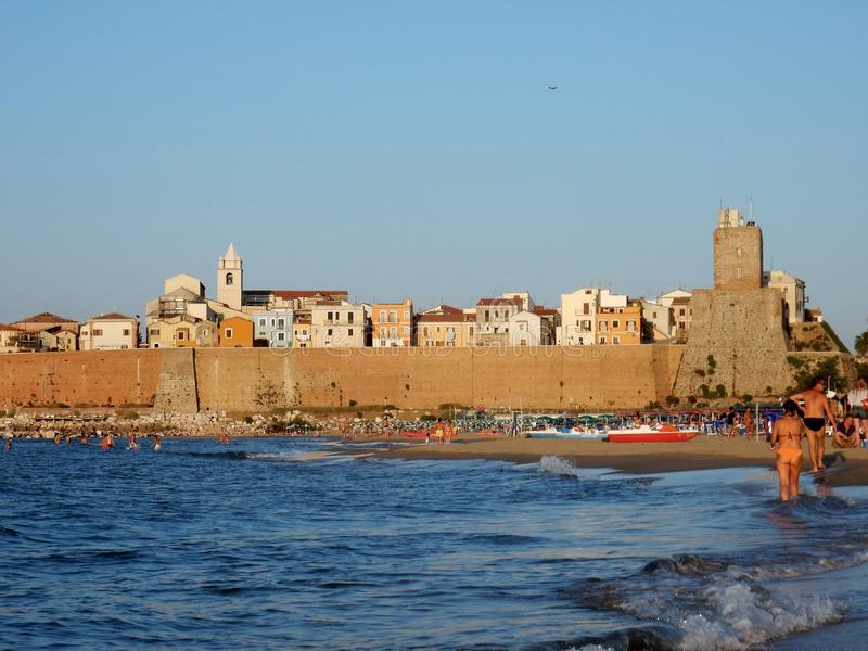 Termoli - Village at sunset from the beach stock photography