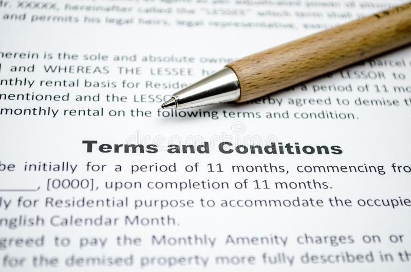 Terms and conditions. Close up with wooden pen stock photo