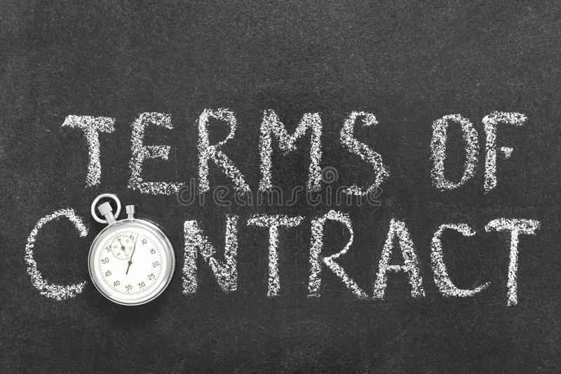 Terms of contract. Phrase handwritten on chalkboard with vintage precise stopwatch used instead of O stock photo