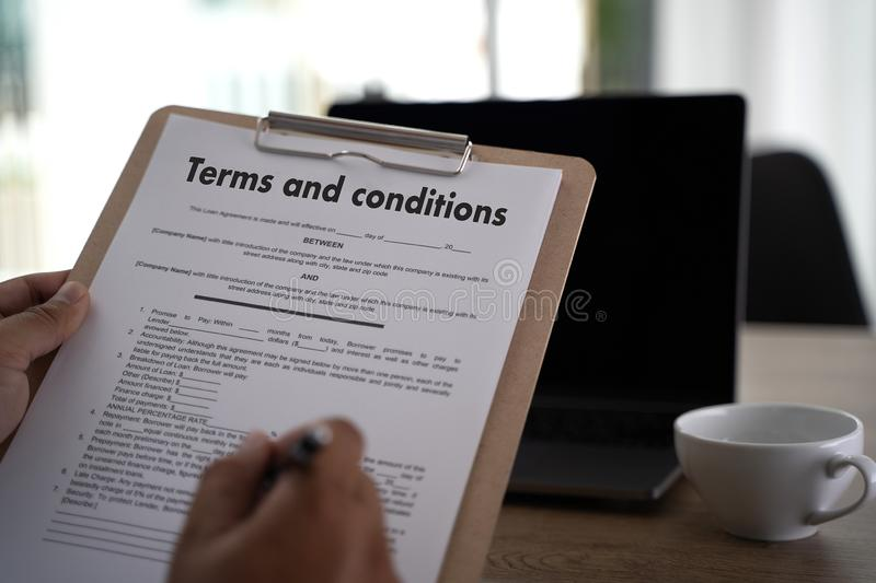 Terms of use confirm terms disclaimer conditions to policy service man use pen Terms and conditions agreement or document. D royalty free stock photography