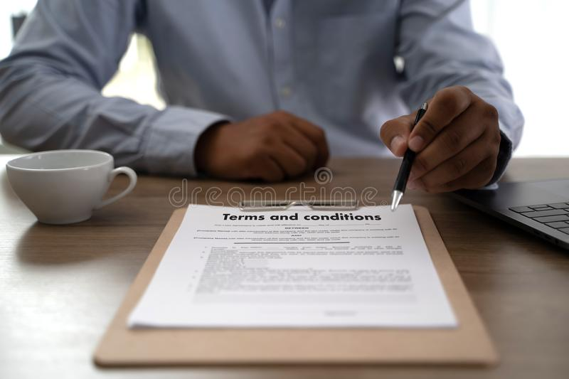 Terms of use confirm terms disclaimer conditions to policy service man use pen Terms and conditions agreement or document. D stock photography