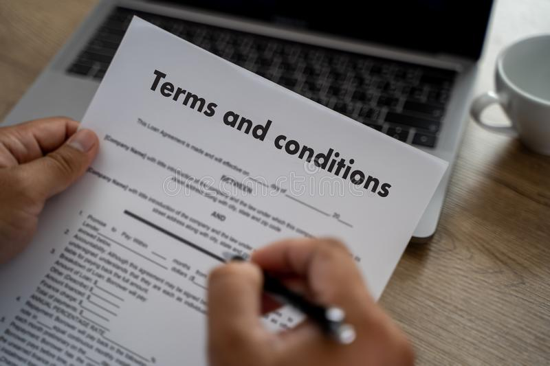 Terms of use confirm terms disclaimer conditions to policy service man use pen Terms and conditions agreement or document. D stock photo
