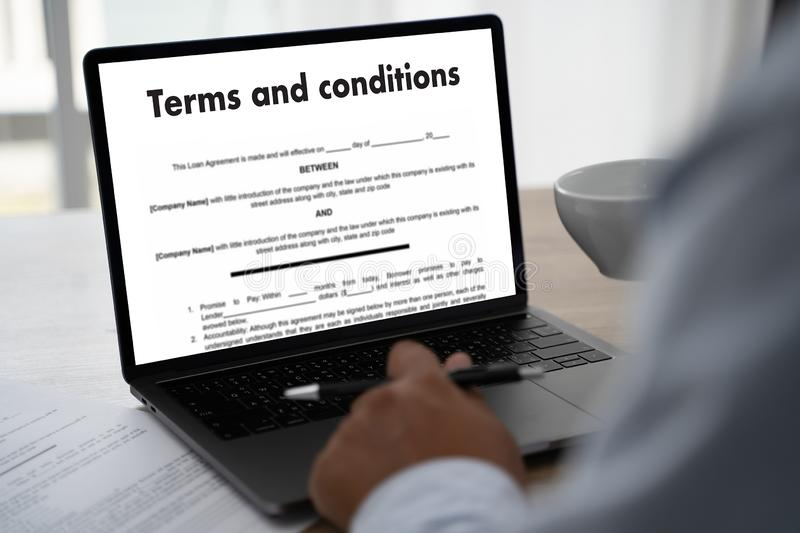 Terms of use confirm terms disclaimer conditions to policy service man use pen Terms and conditions agreement or document. D royalty free stock images
