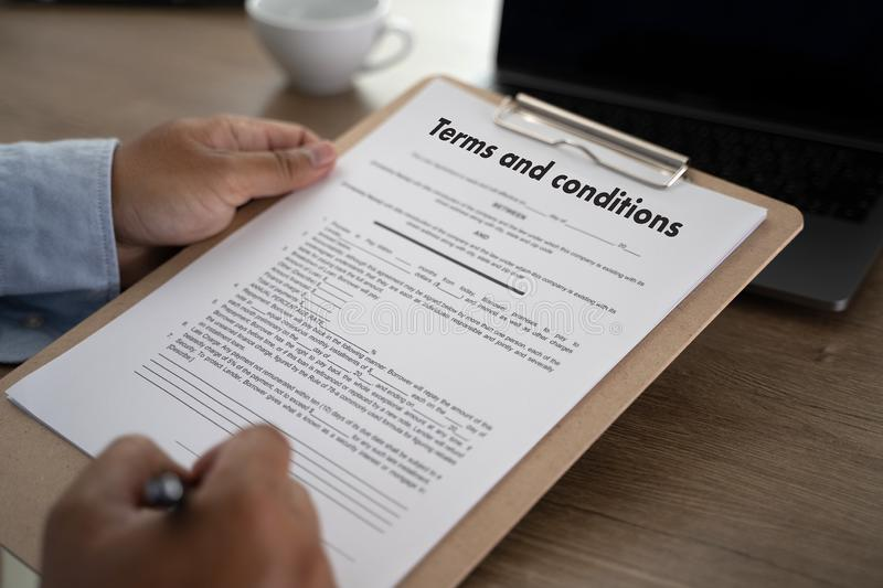 Terms of use confirm terms disclaimer conditions to policy service man use pen Terms and conditions agreement or document. D royalty free stock photos