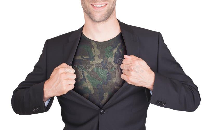 Terno da abertura do homem de negócios para revelar a camisa fotografia de stock royalty free