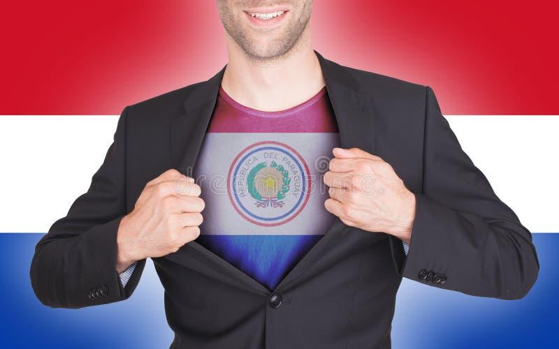Terno da abertura do homem de negócios para revelar a camisa com bandeira fotografia de stock