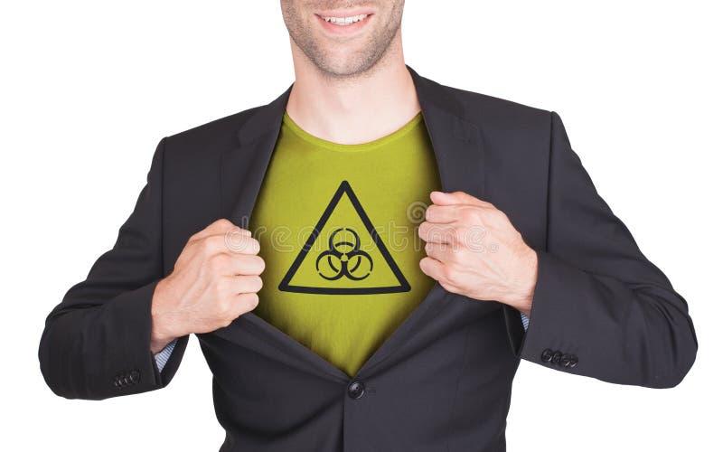 Terno da abertura do homem de negócios para revelar a camisa com símbolo foto de stock