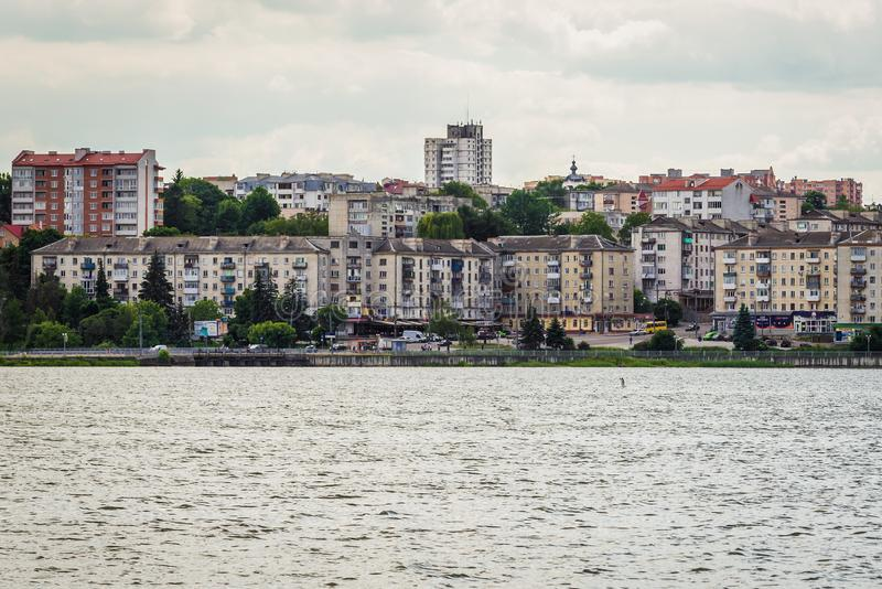 Ternopil in Ukraine. Ternopil, Ukraine - June 9, 2017: Buildings over Ternopil Pond in Taras Shevchenko Park in Ternopil city, administrative center of the royalty free stock photography