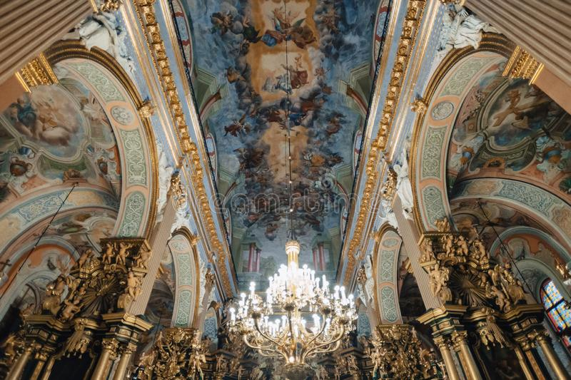Ternopil, Ukraine - 20 October 2018: Cathedral of the Immaculate Conception of the Blessed Virgin Mary, ceiling and chandelier. Editorial stock image