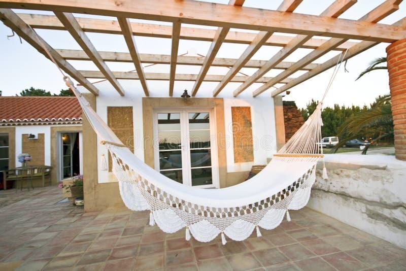 Terraço privado com hammock fotografia de stock royalty free