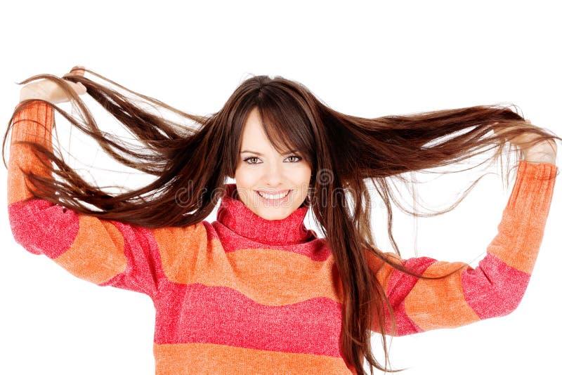 Terra arrendada bonita da mulher seu cabelo longo foto de stock royalty free