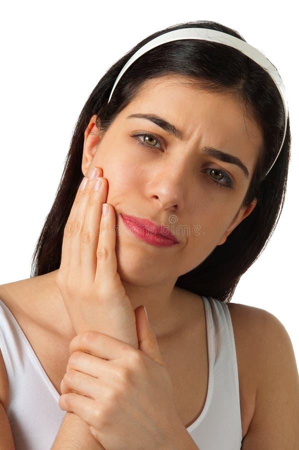 Terra arrendada da menina seu queixo - Toothache - dor imagem de stock