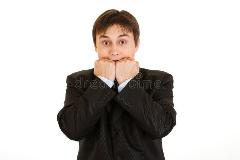 A terra arrendada nova Scared do homem de negócios entrega perto da boca imagens de stock royalty free