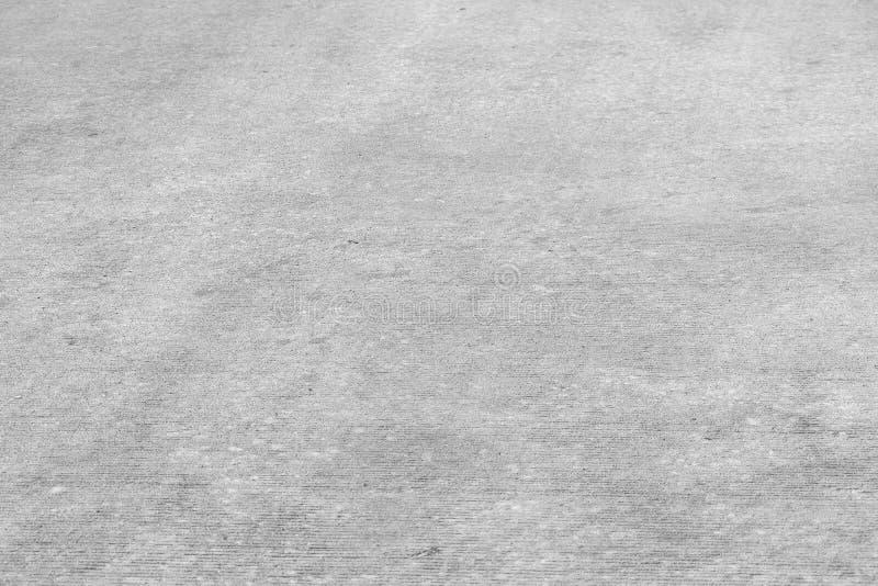 Terra concreta in bianco e nero Struttura del modello del cemento immagini stock