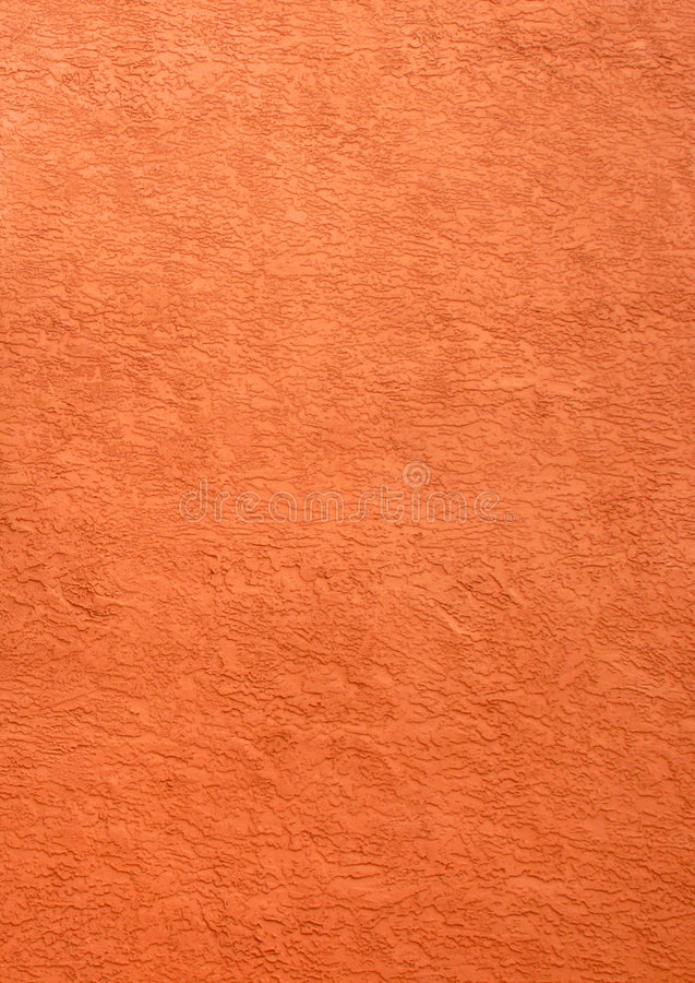 Terra cotta. Sample of rich color, terra cotta; could be used for background. Part of building wall stock image