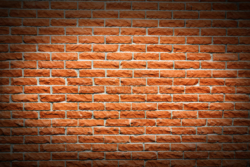 Terra cotta brick wall background. Another great brick wall background, orange terra cotta color, with follow spot highlight making a frame stock photo