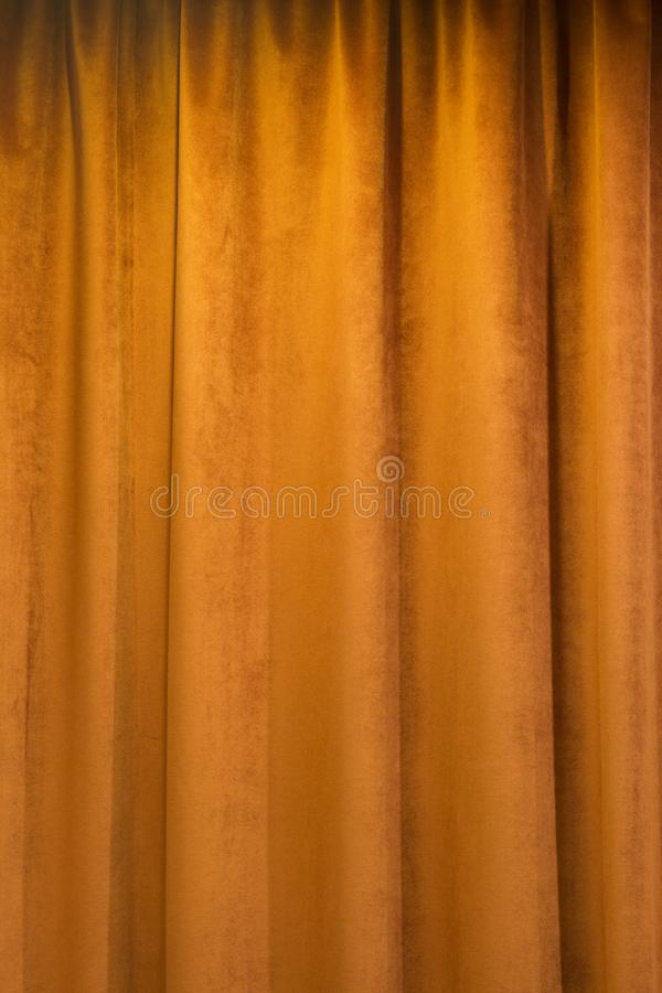Terra cotta colored curtain. Indoors, abstract background royalty free stock photo