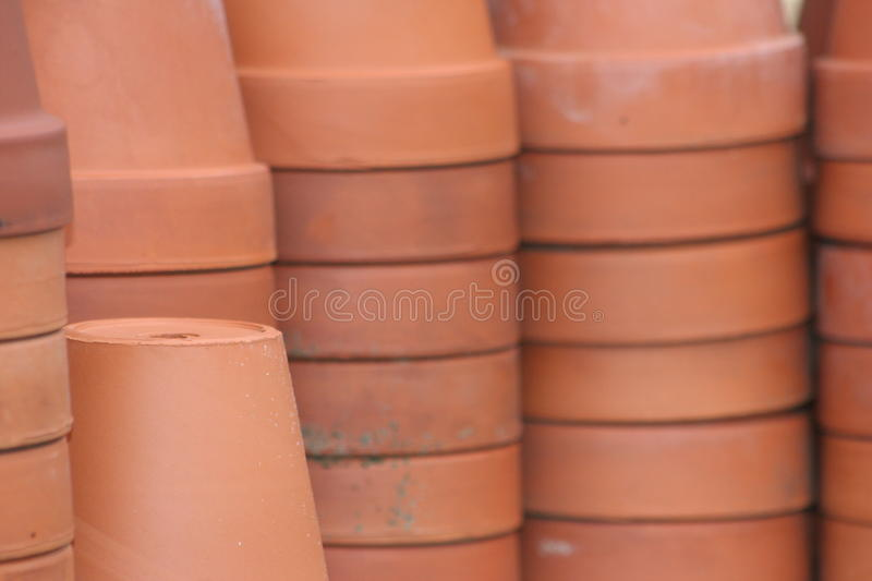 Terra cotta flower pots. Used vintage terra cotta flower pots some with expansion cracks and imperfections, natural color natural light unedited image stock photos