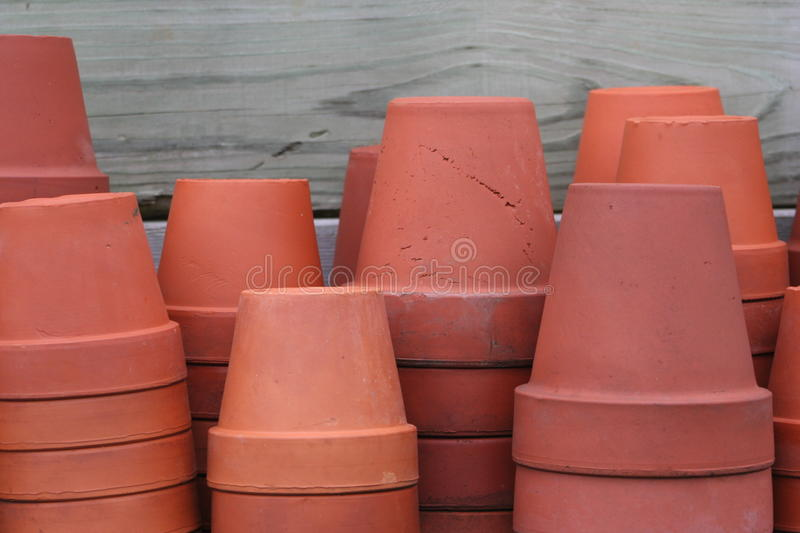 Terra cotta flower pots. Used vintage terra cotta flower pots some with expansion cracks and imperfections, natural color natural light unedited image stock images
